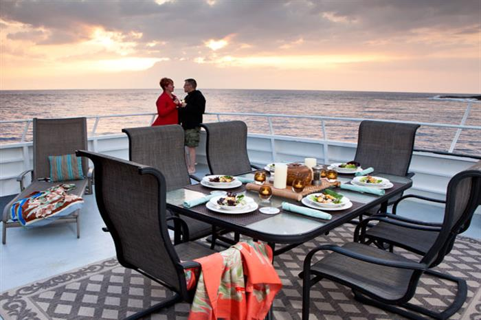 Outdoor dining aboard Kona Aggressor II Liveaboard