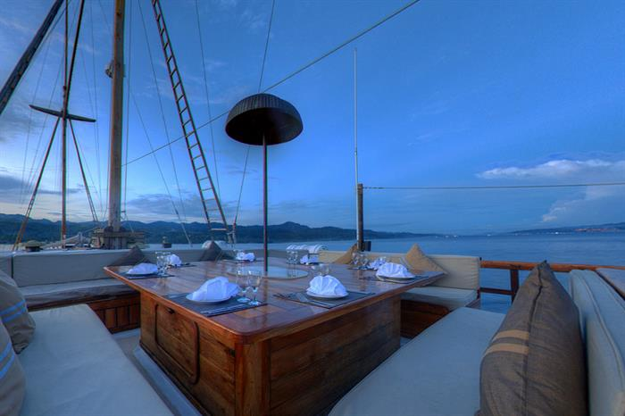 Beautiful outdoor dining area aboard Damai II Indonesia