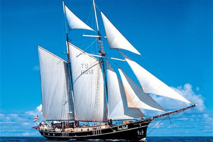 Sea Shell Liveaboard with sails up