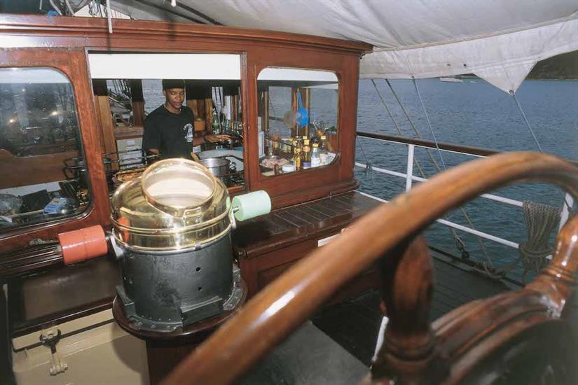 Cook preparing food onboard Sea Shell Liveaboard