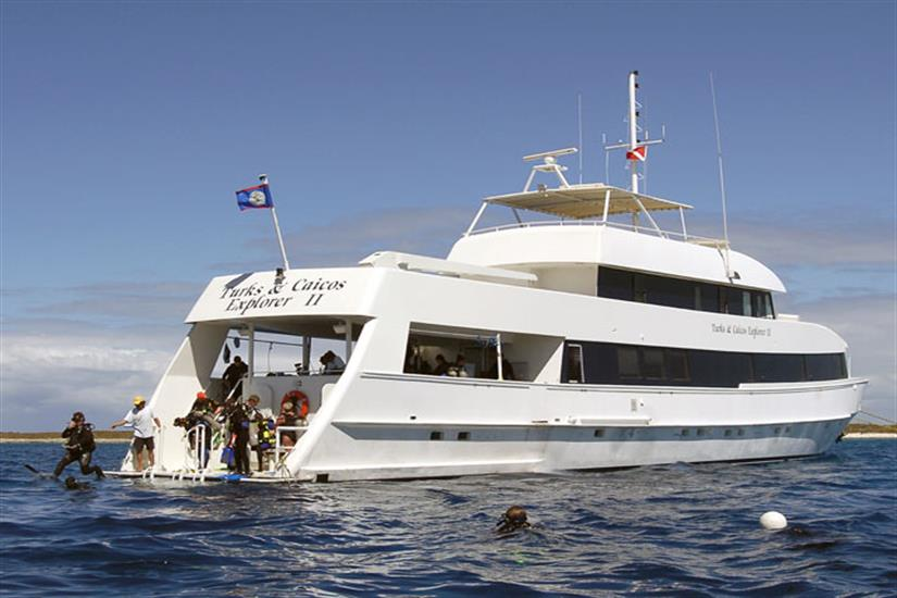 Turks and Caicos Explorer II with divers entering the water