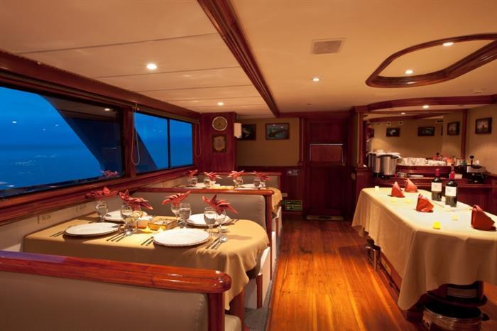 Spacious dining area onboard Galapagos Sky