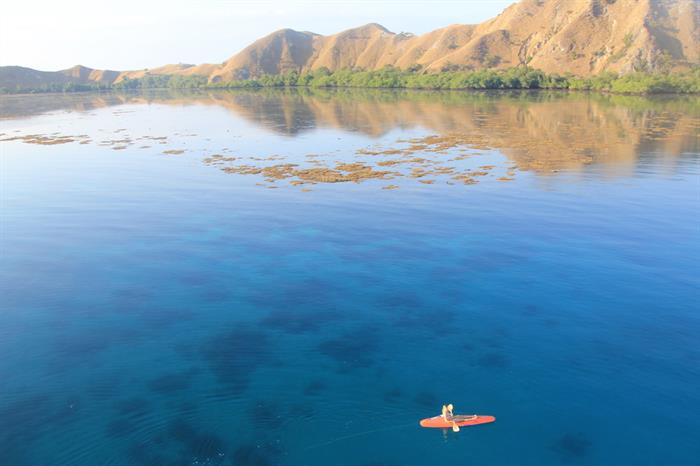 Kayaking on crystal clear waters in Komodo