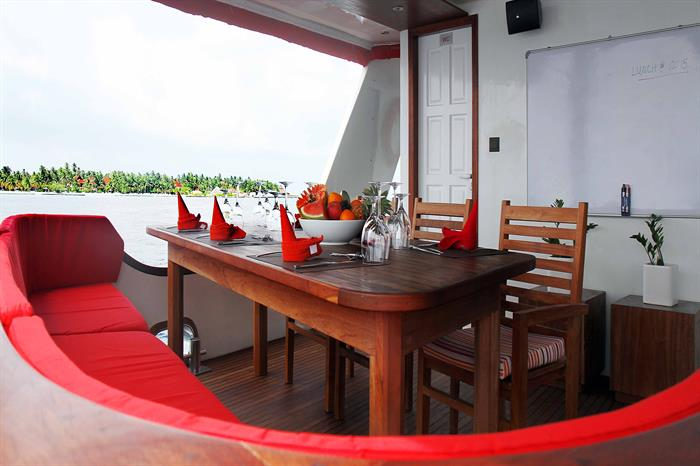 Outdoor dining area - MV Theia