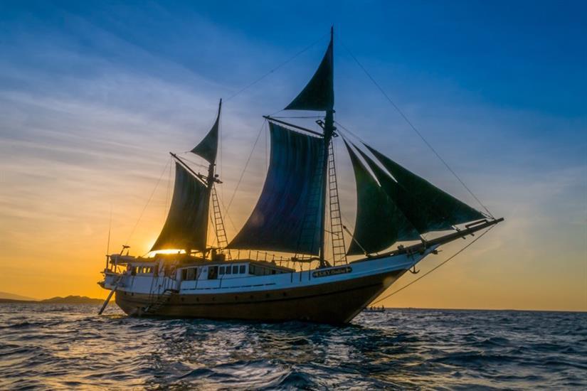 SMY Ondina full sail at sunset