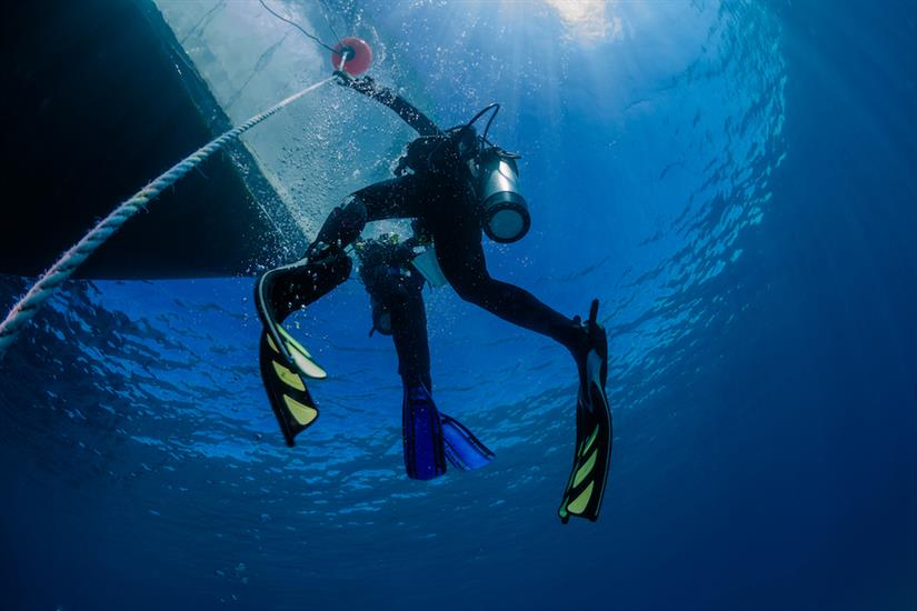 Divers returning back to ScubaPro III