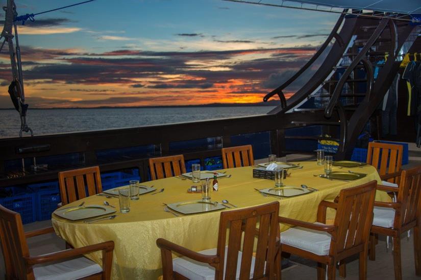 Beautiful outdoor dining Dewi Nusantara Liveaboard Indonesia