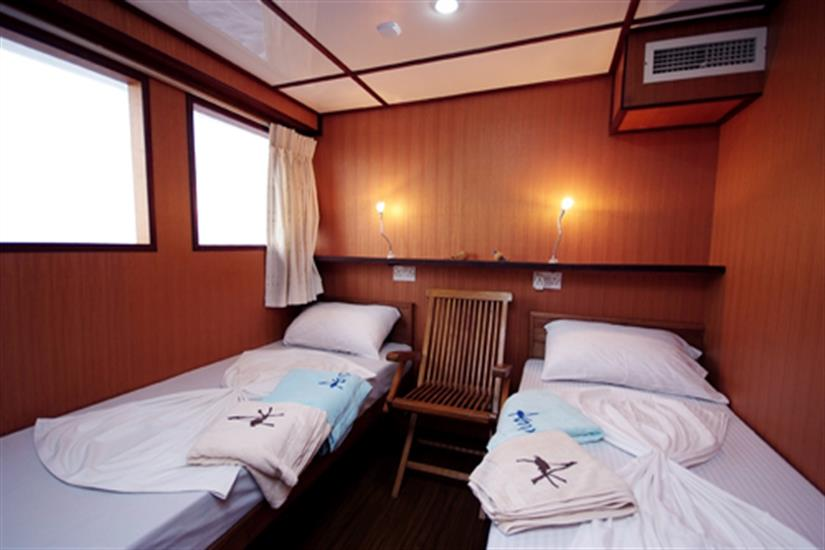 Twin Bedroom Fully Air Conditioned with attached toilet