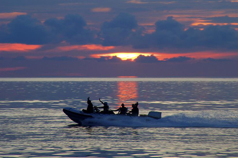 Divers can enjoy stunning Wakatobi sunsets before dropping in.