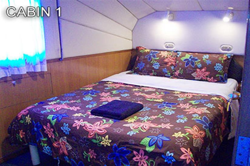 Cabin 1 with a double bed, airconditioning and ensuite on mid-deck