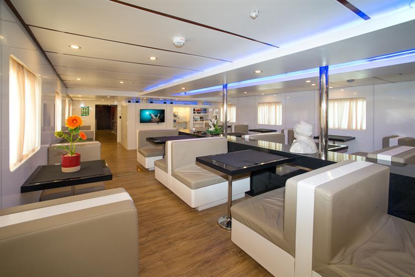 MV Discovery Palawan - Indoor salon/dining area