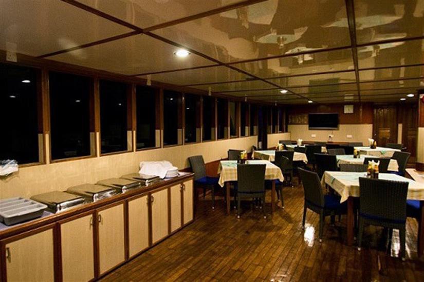 Indoor dining area - MV Ari Queen