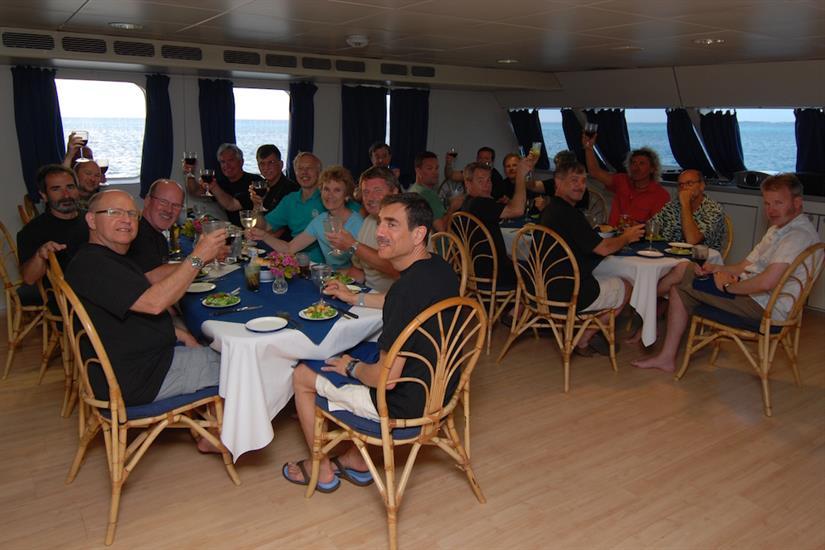 Passengers eating dinner.