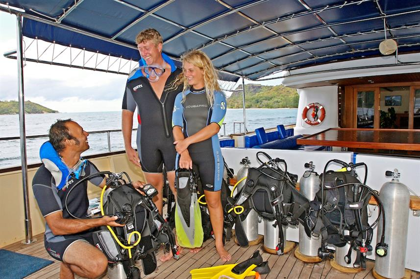 Divers in dive area onboard Sea Bird Liveaboard