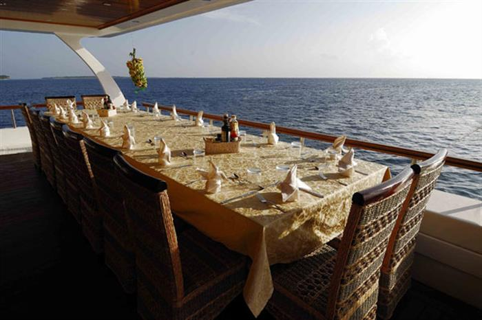 Outdoor dining with views onboard Princess Dhonkamana