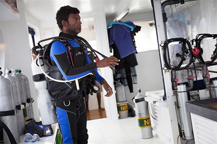 Diver on dive dhoni - Duke of York Liveaboard