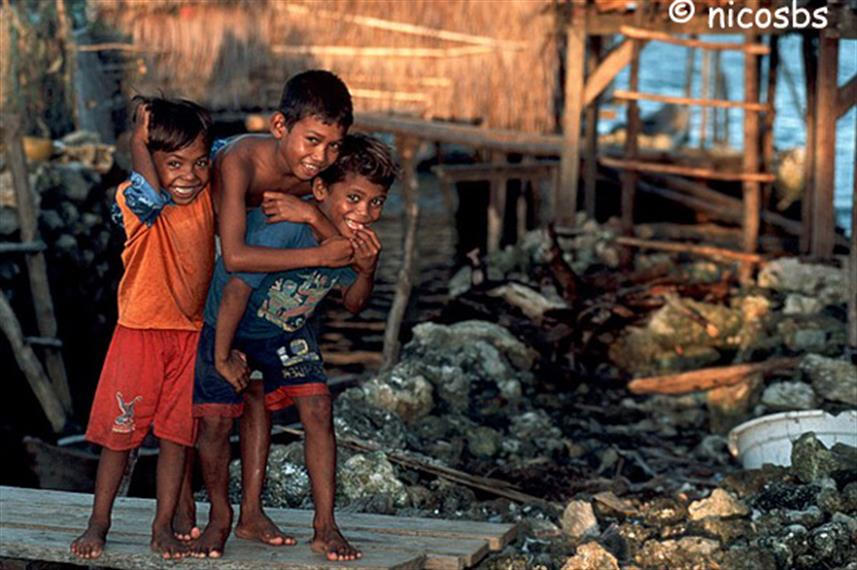 Curious kids in Raja Ampat Indonesia