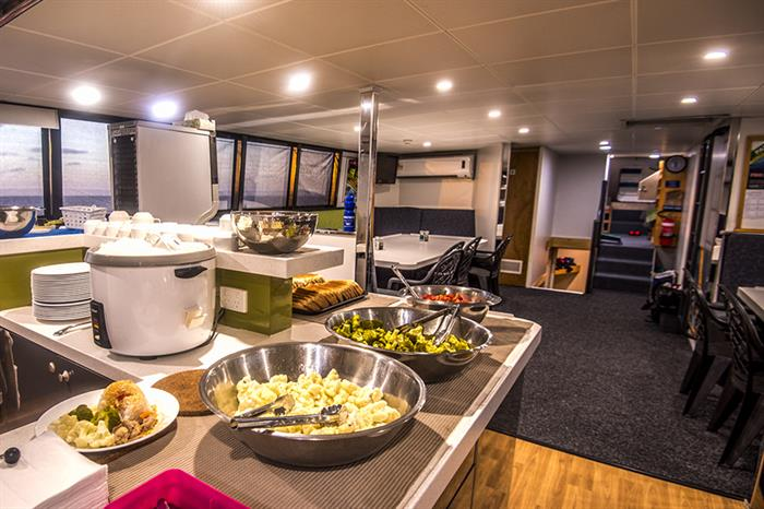 Breakfast in the dining area onboard ScubaPro II