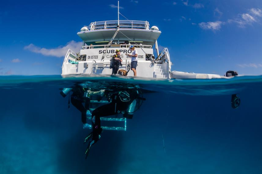 Divers at the dive platform onboard ScubaPro III