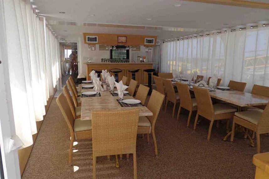 Spacious indoor dining area - Avalon II Liveaboard