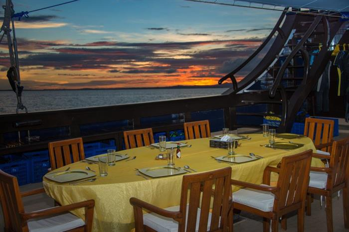 Beautiful outdoor dining Dewi Nusantara Liveaboard Indonesia