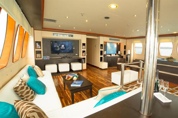 Comfortable indoor lounge and bar area - Majestic Galapagos Yacht
