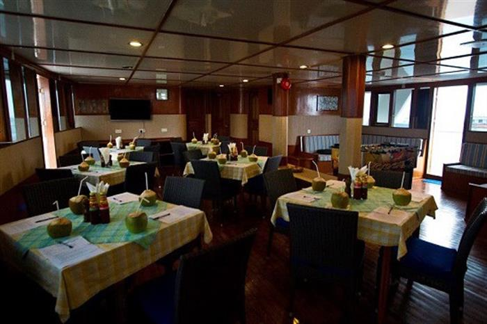 Spacious dining area aboard the MV Ari Queen