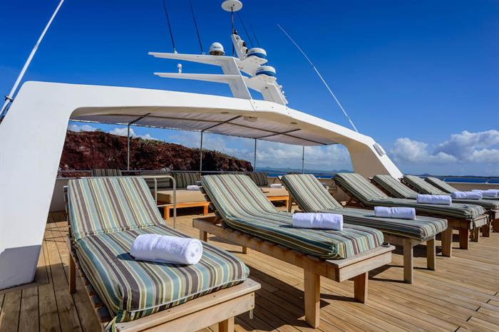 Comfortable loungers on the sun deck - Galapagos Seaman Journey