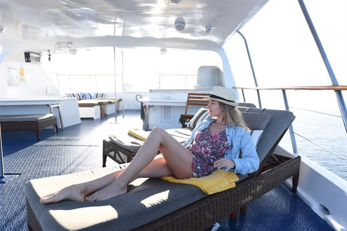 Lounging on the sun deck - M/Y Coral I and II Galapagos